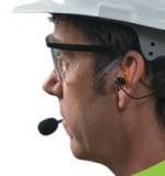 worker with dB blocker in ear